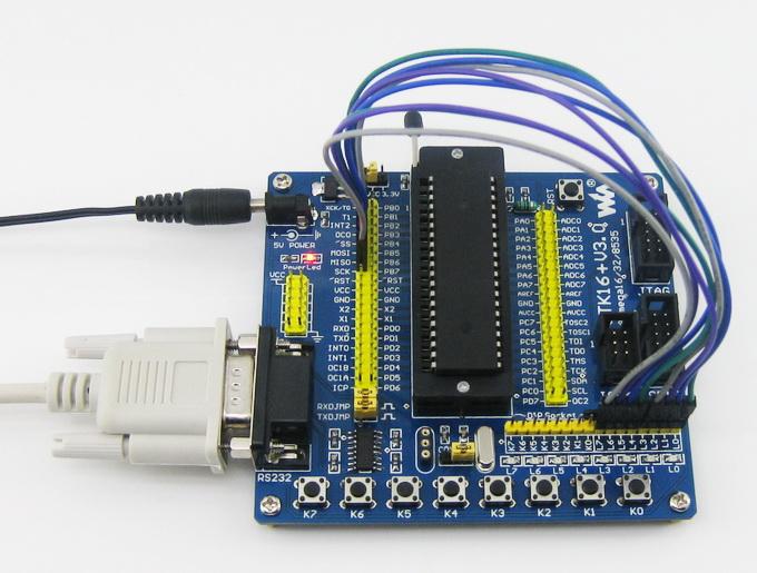 """本10-pin ISP接口兼容ATMEL指定的10-pin ISP标准接口,但不输出ISP的PIN4 """"GND"""",它对应JTAG的PIN4为""""VCC""""。 改进后优点:ISP错插入MCU的JTAG接口,不会导致烧器件(需要目标板的JTAG、ISP接口做相关处理)。"""